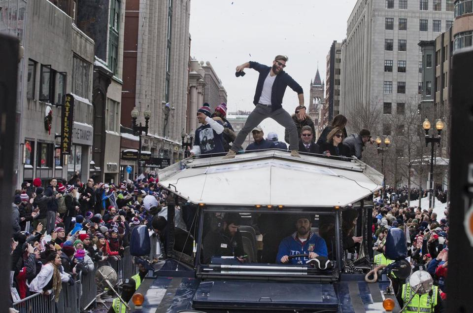 Boston, Ma-February 4, 2015- Globe Staff Photo by Stan Grossfeld-Patriots Victory Parade- Patriots Julian Edelman finds the Victory Parade a slam dunk as it goes down Boylston Street.